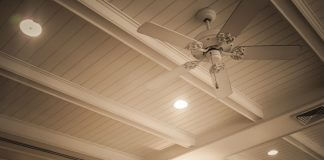 Ceiling with beams, lights and fan