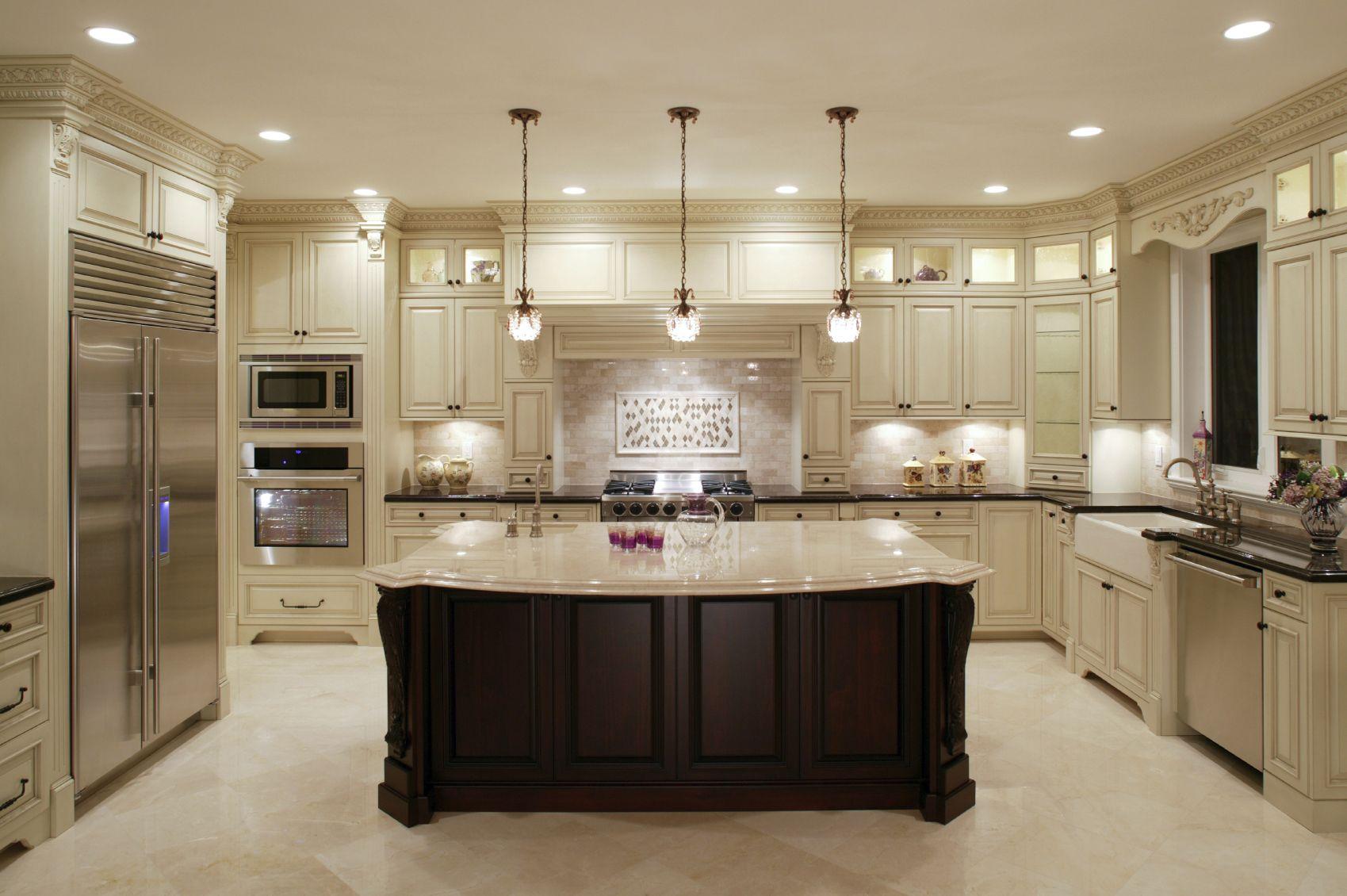U-shaped luxurious large kitchen with pendant lights