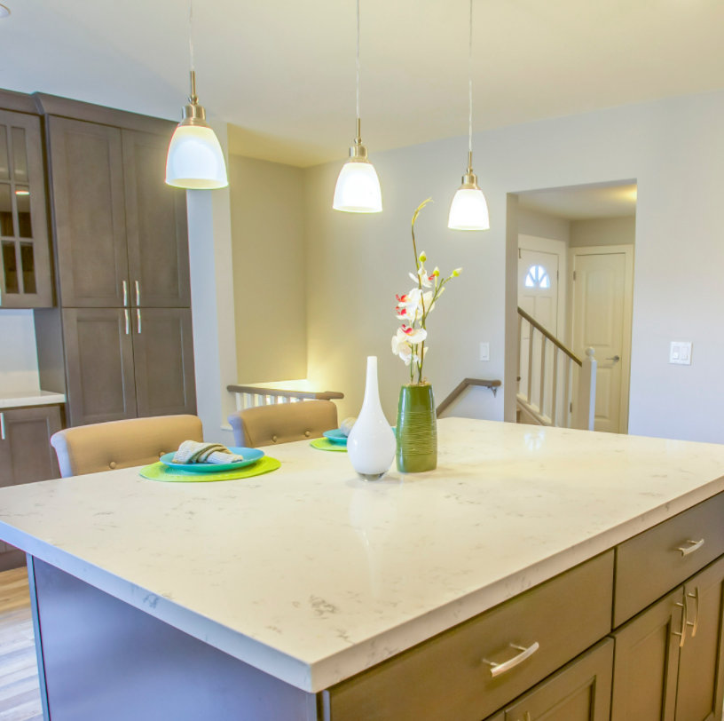 small kitchen island with pendant lights