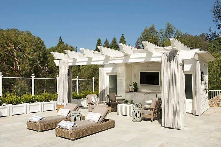 white pool house with pergola covered porch