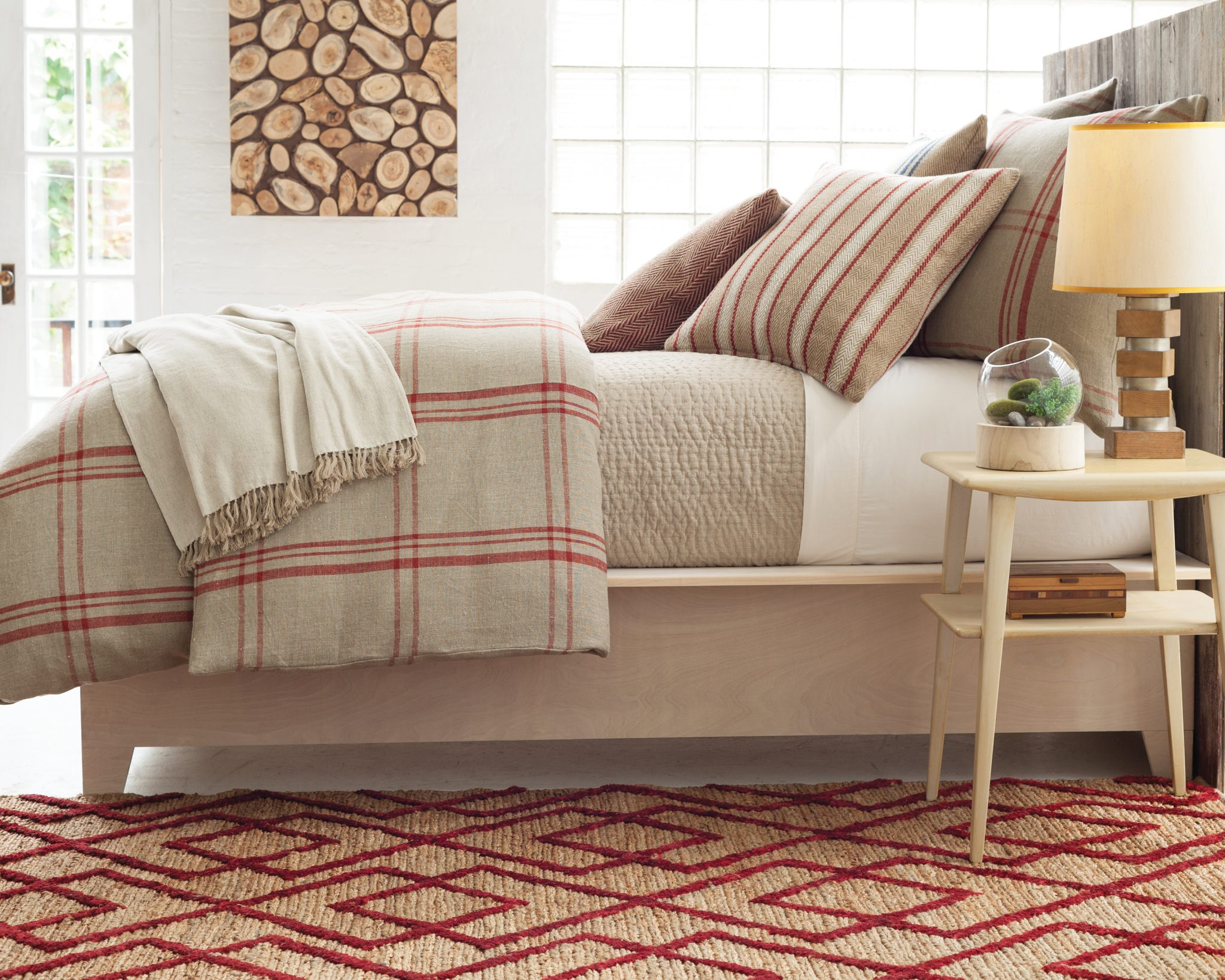 rustic bedroom with woven rugs