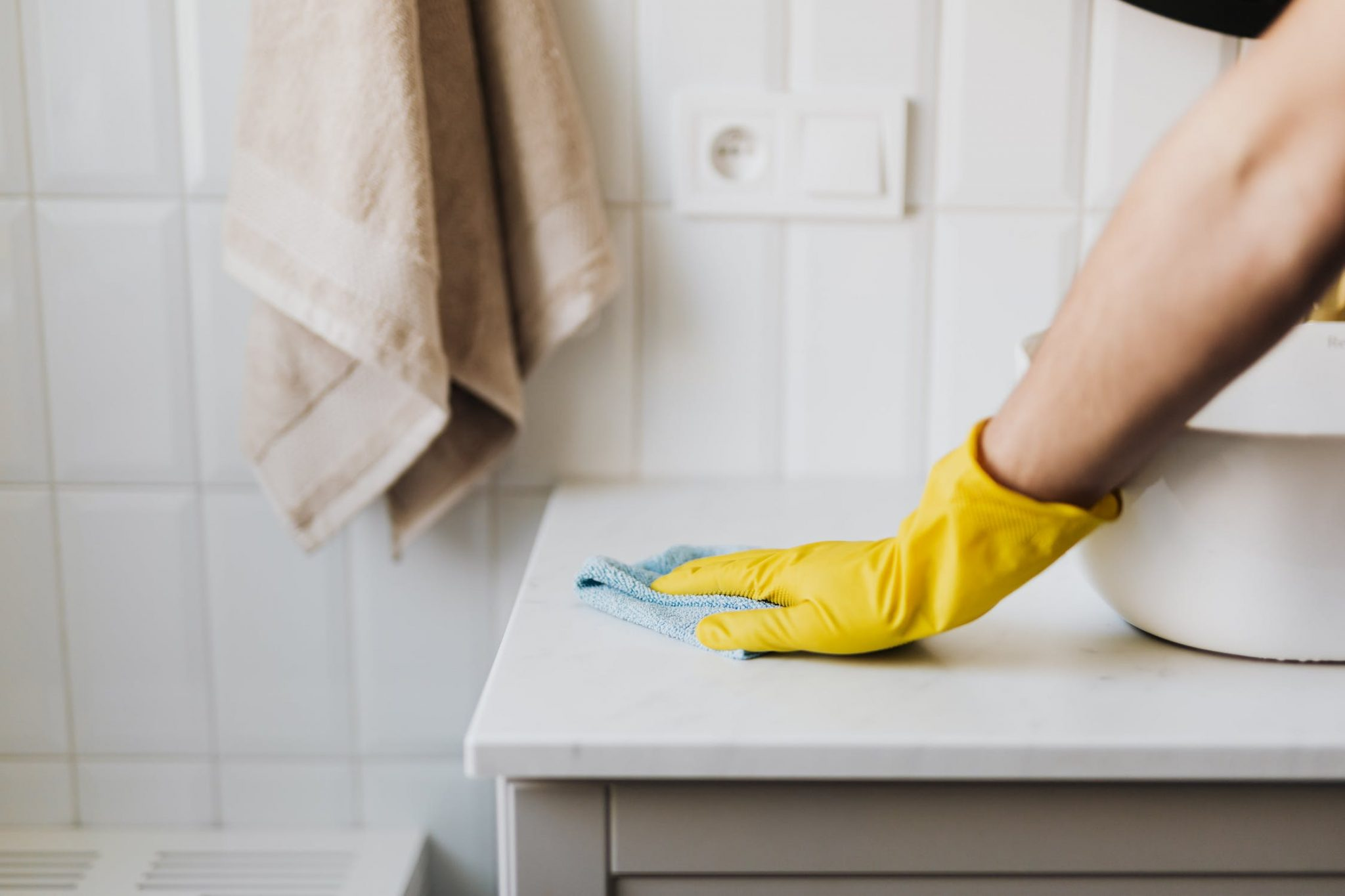 wiping cabinet surface
